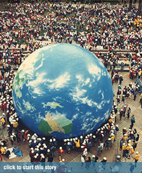 top view of a crowd around a very large globe