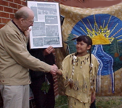 Nelson greets Mariah Star, a Chippewa girl, at a 2003 ceremony honoring his work